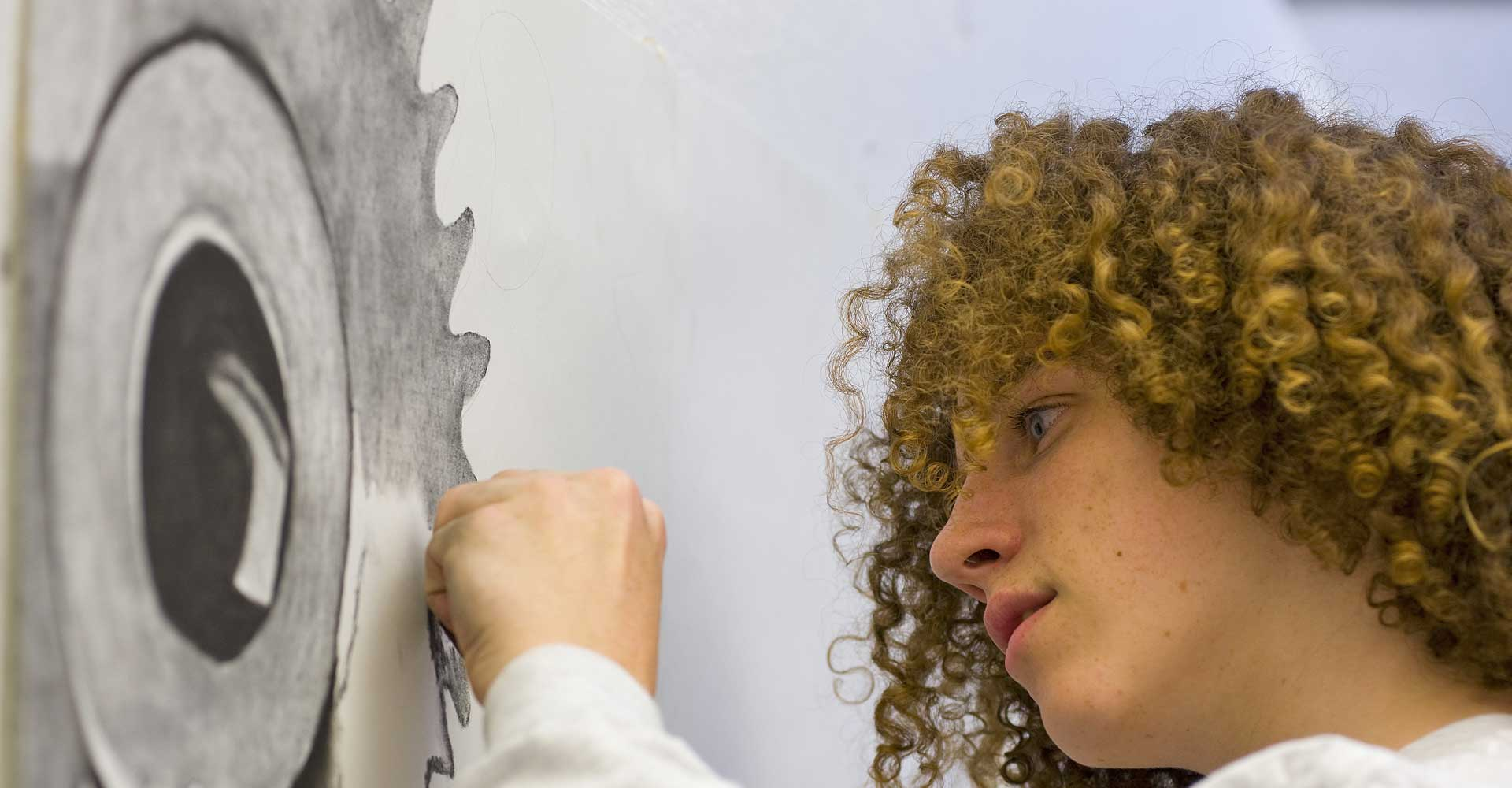 Student working on a piece of art
