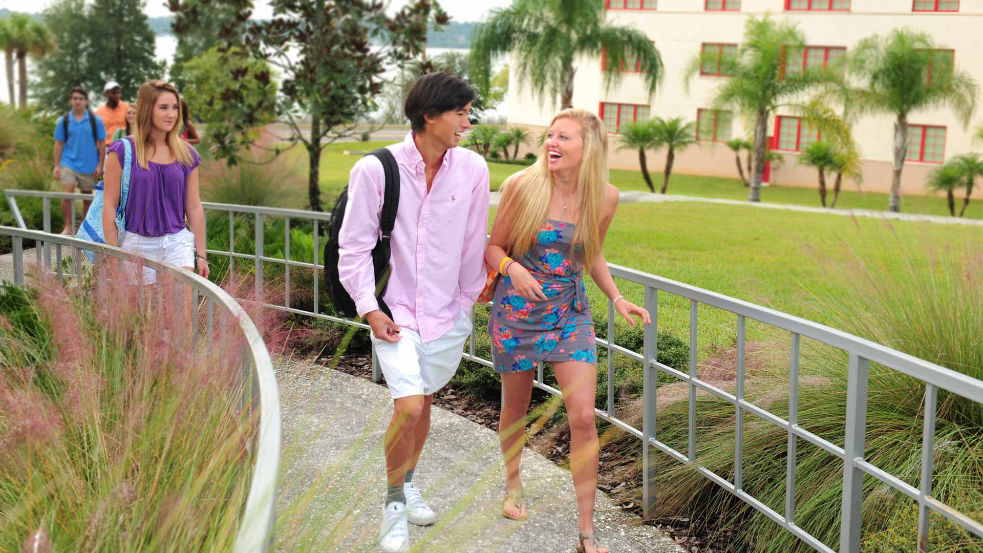 students walking around the beautiful florida southern campus on a sunny day