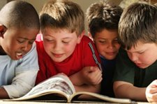 Children sharing a book and learning to read