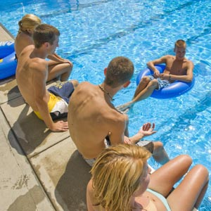 Students hanging out at pool