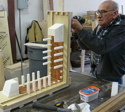 Photo: Eugene Castonguay crafting a block mold for the Sharp Family Tourism and Education Center.